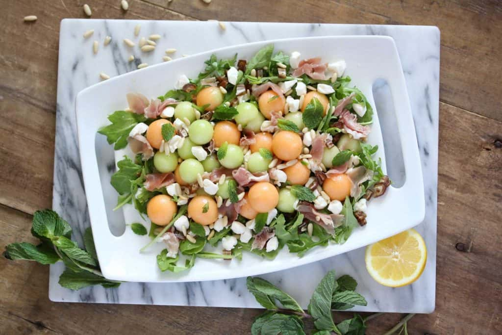 Salad on white serving platter.