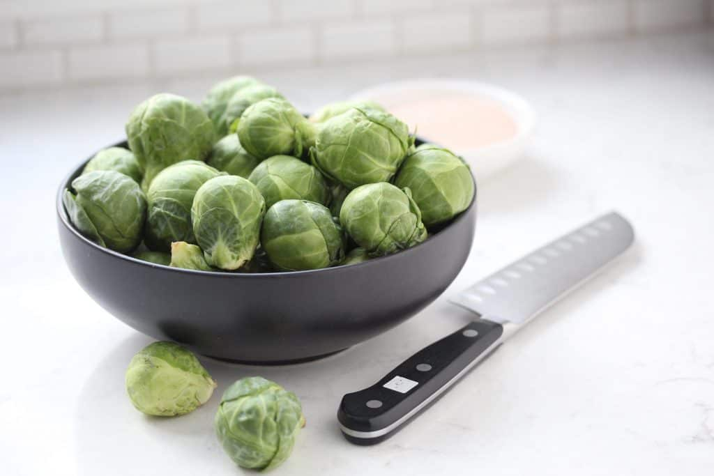 Brussels sprouts in grey bowl.