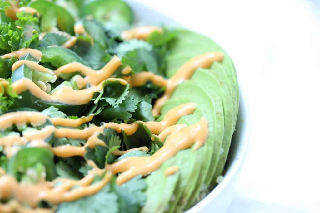 Greens and avocado drizzled with spicy mayo.
